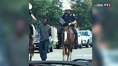 États-Unis : deux policiers blancs à cheval tirent un suspect noir par une corde
