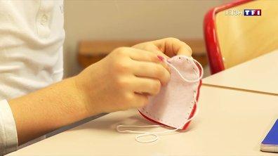 Les enfants préparent des cadeaux faits mains pour leur maman