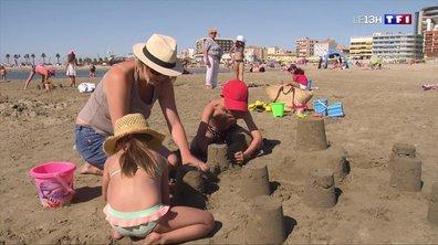 Vacances : le fameux château de sable se construit en famille